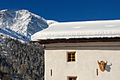 The guesthouse Yak & Yeti in front of snowy mountains in the sunlight, Sulden, Val Venosta, South Tyrol, Italy, Europe