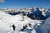A man at ascent in a snowy mountain scenery, Dolomites, South Tyrol, Italy, Europe