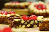 Christmas baking, fruitcake with pine nuts and candied cherries, South Tyrol, Italy, Europe