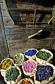 Sacks of medicinal herbs in front of an alpine hut in the sunlight, Siusi, Valle Isarco, South Tyrol, Italy, Europe