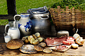 Picnic with South Tyrolean ham, bread and potatoes, Alpine meadow, Agriculture, South Tyrol, Italy