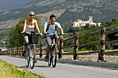 Couple cycling near Churburg, Bike tour through Vinschgau with the Vinschger Railway, Rail and Bike, Churburg, Schluderns, Vinschgau, South Tyrol, Italy