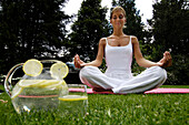 Woman sitting cross-legged, doing yoga exerceses, Meditation, Relaxation, Wellness, Holiday, South Tyrol, Italy