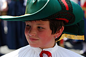 Detail of traditional costume in Kastelruth, boy wearing hat, music band, Kastelruth, South Tyrol, Italy