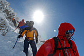 Mountaineers, climbers in Winter clothing descending the mountain, Mountain landscape, Wildspitze, South Tyrol, Italy