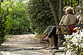Two women sitting on a bench, Guntschna promenade, Bozen, South Tyrol, Italy