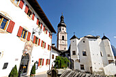 Village centre with Hotel zum Turm and the parish church of St Peter and Paul, Kastelruth, Castelrotto, South Tyrol, Italy