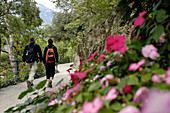 Two hikers with backpack on the Tappeiner trail, Meran, Val Venosta, South Tyrol, Italy, Europe