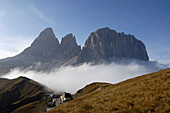 Hotel Maria Flora at a mountain pass in front of mountain tops in the morning mist, Dolomites, South Tyrol, Italy, Europe