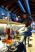 A man sitting in the bar of Hotel Bad Schörgau, Bad Schörgau, Valley Sarntal, South Tyrol, Italy, Europe