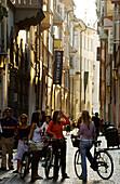 Teenagers in the city center, Laubengasse, Bolzano, South Tyrol, Italy