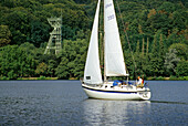 Shaft tower and sailboat on lake Baldeney, Essen, Ruhr, Ruhr valley, Ruhr area, North Rhine Westphalia, Germany