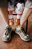 Adult, Adults, Affection, Babies, Baby, Body, Body part, Body parts, Boy, Boys, Child, Childhood, Children, Close up, Close-up, Closeup, Color, Colour, Contemporary, Contrast, Contrasts, Detail, Details, Difference, Families, Family, Feet, Fondness, Foot,