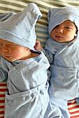 Two newborn babies