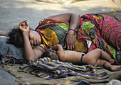 Mother and son sleeping in the streets of Calcutta, India