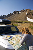 Female hiker planning a route up Mt  Sneffels in the Sneffels Wilderness, San Juan Mountains, Colorado, USA