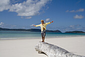 Man with arms outstretched.  Whitehaven Beach, Australia.