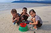 Kids having fun on a beautiful tropical beach in Langkawi, Malaysia