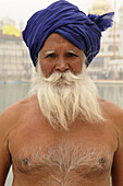 An old Sikh man in the Golden temple in Amritsar, India  As part of his visit to the Golden temple this man will take a bath in the holy pool which surrounds the temple