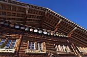 Row of cow bells, mountain restaurant Aebi, Adelboden, Bernese Oberland, Canton of Berne, Switzerland