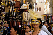 Tourist with mask at Mercato del Porcellino, Loggia del Mercato Nuevo, Florence, Tuscany, Italy, Europe