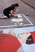 Street artist painting with chalk at Mercato Nuevo, Florence, Tuscany, Italy, Europe