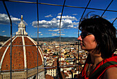 View at the cathedral and over the city, a middle-aged woman looking at the view, Florence, Tuscany, Italy, Europe