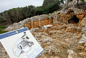 Prehistoric monument at Torre d´en Galmes with information board, Minorca, Balearic Islands, Spain