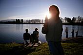 People at lake Staffelsee, Uffing, Bavaria, Germany