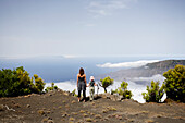 Hiker, mother and daughter admiring the view over El Golfo, clouds, Camino de la Virgin, Malpaso, El Hierro, Canary Islands, Spain