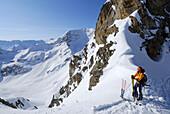 Backcountry skier looking to Stubai range, Kuehtai, Tyrol, Austria