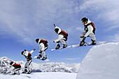 Snowboarder jumping from a kicker, ski area Soelden, Oetztal, Tyrol, Austria