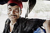 20 to 25 years, 20 to 30 years, 20-25 years, 20-30 years, Driver, Eyes, Face, Headband, India, Man, Portrait, Rickshaw, Scary, Smile, Twenties, F17-704603, agefotostock