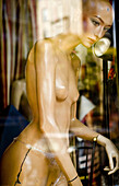 Bare, Color, Colour, Concept, Concepts, Daytime, Dummies, Dummy, exterior, female, Glass, Lifeless, Lifelessness, Mannequin, Mannequins, Naked, Nude, Nudes, Nudity, One, outdoor, outdoors, outside, Reflection, Reflections, Shop window, Shop windows, woman
