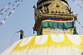 Nepal. Kathmandu valley. Swayambunath stupa. The stupa is regularly paint with saffron water in order to purify it.