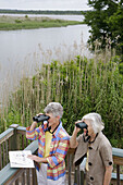 Alabama, Mobile Bay, Spanish Fort, Mobile Tensaw River, 5 Rivers Delta Resource Center, nature, education, woman, women, senior, binoculars, birding