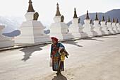 China  Yunnan  Shangri-La region  Dequin, called Shangri-La  Road from Zhongdian to Dequin, on the Tibetan Border Buddhist Stupa  Naxi Woman