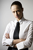 Adult, Adults, Angry, Arms crossed, Arms folded, Bad mood, Brunette, Brunettes, business, Businesspeople, Businessperson, Businesswoman, Businesswomen, Caucasian, Caucasians, Clipping path, Color, Colour, Contemporary, Cross arms, Cross-armed, Crossed arm