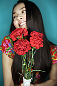 Adult, Adults, asian, asians, Bouquet, Bouquets, Carnation, Carnations, Color, Colour, Contemporary, Decoration, Ethnic, Ethnicity, Female, flower, flowers, grin, grinning, happiness, happy, Hold, Holding, human, joy, One, One person, people, person, pers