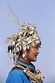 Miao woman with silver headdress, duan new year festival, dabian village, guizhou, China
