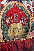 Monks unrolling a huge thangka or thongdrel representing the shabdrung, Bhutan's greatest ruler, punakha tsechu festival, punakha, Bhutan