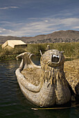 Peru, Lake Titicaca, floating islands of the Uros people, traditional reed boat