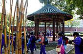 School class walking through park to Koxinga's shrine, Tainan, Taiwan, Asia