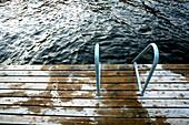 View at a wet jetty at a lake, Saimaa Lake District, Finland, Europe