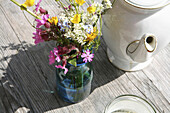 A bouquet of meadow flowers on a wooden table, Arzmoos, Sudelfeld, Bavaria, Germany