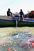 Moken people, sea gypsies on a boat fishing, Mergui Archipelago, Andaman Sea, Myanmar, Burma, Asia