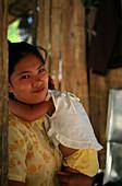 Sea gypsies, Moken mother and child, Mergui Archipelago, Andaman Sea, Myanmar, Burma, Asia