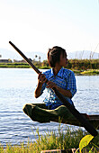 Intha girl rowing on water way, Inle Lake, Shan State, Myanmar, Burma, Asia