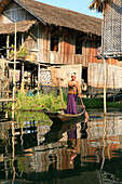Intha man standing in his boat rowing, Inle Lake, Shan State, Myanmar, Burma, Asia