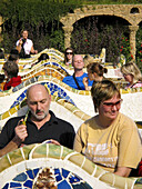 Tourists seated on the benches  Güell Park by Antoni Gaudí  Barcelona  Catalonia, Spain